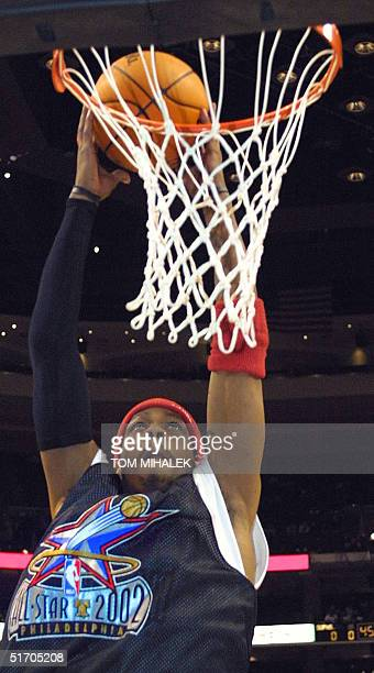 Allen Iverson of the East All Stars dunks the ball during a warmup and practice session today 09 Feb 2002 in the First Union Center in Philadelphia...