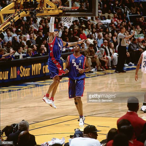 Allen Iverson of the East AllStars drives to the basket against the West AllStars during the 2004 NBA AllStar Game at the Staples Center part of the...