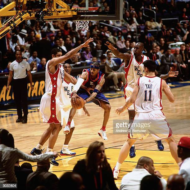 Allen Iverson of the East AllStars looks to pass the ball against the West AllStars defense during the 2004 NBA AllStar Game at the Staples Center...