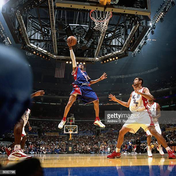 Allen Iverson of the East AllStars takes a layup against Tim Duncan of the West AllStars during the 2004 NBA AllStar Game at the Staples Center part...