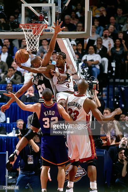 Allen Iverson of the Eastern Conference AllStars attempts a layup against Tim Duncan of the Western Conference AllStars during the 2000 NBA AllStar...