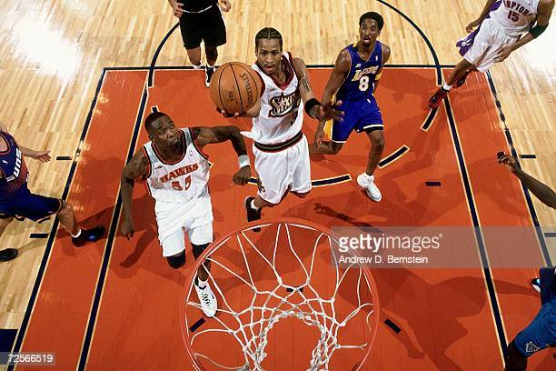 Allen Iverson of the Eastern Conference AllStars attempts a layup against Kobe Bryant of the Western Conference AllStars during the 2000 NBA AllStar...