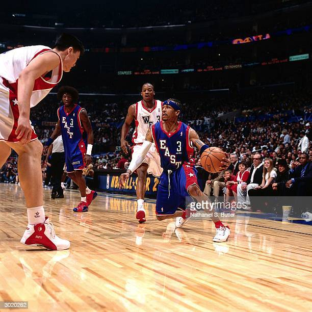 Allen Iverson of the Eastern Conference AllStars dribble drives against Yao Ming of the Western Conference AllStars during the 2004 AllStar Game on...