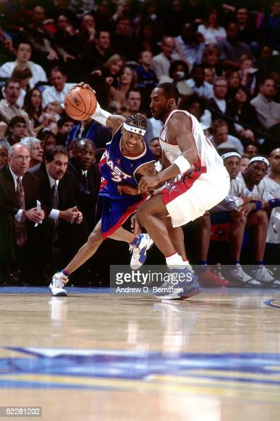 Allen Iverson of the Eastern Conference AllStars drives against Kobe Bryant the Western Conference AllStars during the 2005 AllStar Game on February...