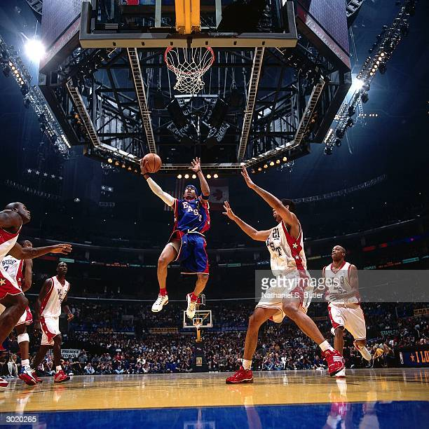 Allen Iverson of the Eastern Conference AllStars drives against Tim Duncan of the Western Conference AllStars during the 2004 AllStar Game on...