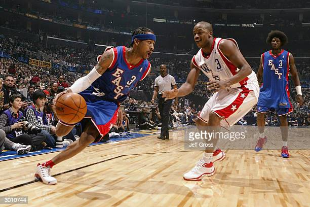 Allen Iverson of the Eastern Conference AllStars drives around Steve Francis of the Western Conference AllStars during the 2004 NBA AllStar Game part...