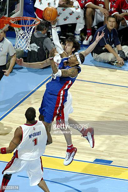 Allen Iverson of the Eastern Conference AllStars goes for a layup against Manu Ginobili of the Western Conference AllStars during the 2005 NBA...