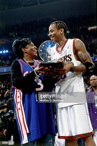 Allen Iverson of the Eastern Conference AllStars hands his mother the 2002 AllStar Game MVP Trophy during the 2002 NBA AllStar Game on February 10...
