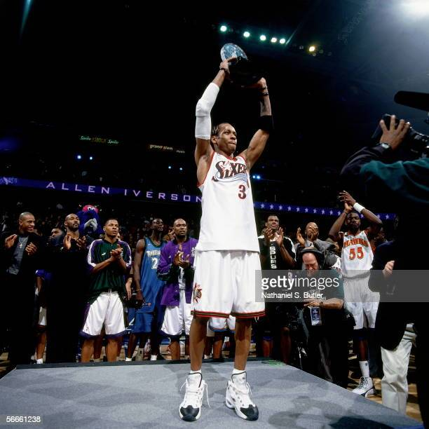 Allen Iverson of the Eastern Conference AllStars hoists the 2002 AllStar Game MVP trophy after the 2002 NBA AllStar Game on February 10 2002 at the...