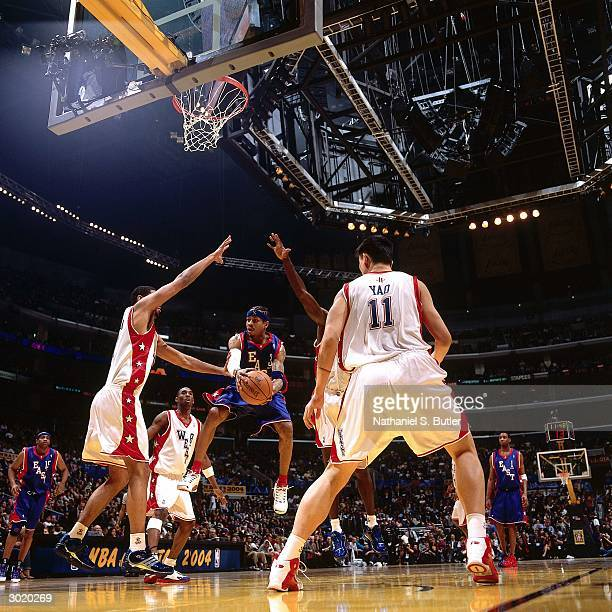 Allen Iverson of the Eastern Conference AllStars looks to pass against Yao Ming and Tim Duncan of the Western Conference AllStars during the 2004...