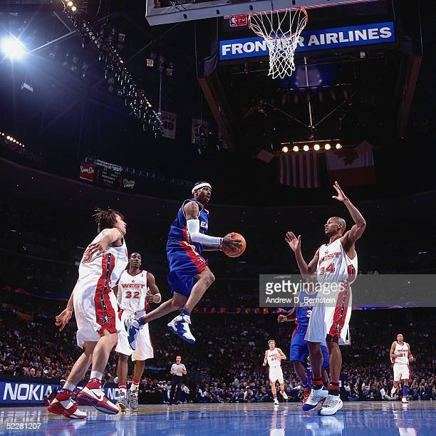 Allen Iverson of the Eastern Conference AllStars passes against Steve Nash and Ray Allen of the Western Conference AllStars during the 2005 AllStar...