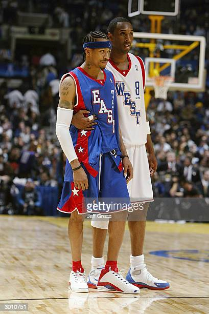 Allen Iverson of the Eastern Conference AllStars talks with Kobe Bryant of the Western Conference AllStars during the 2004 NBA AllStar Game part of...