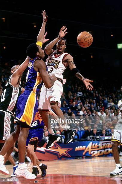 Allen Iverson of the Eastern Conference AllStars throws a pass against Kobe Bryant of the Western Conference AllStars during the 2000 NBA AllStar...
