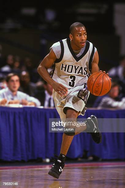 Allen Iverson of the Georgetown Hoyas dribbles the ball up court during a basketball game against the Boston College Eagles at Capital Centre on...