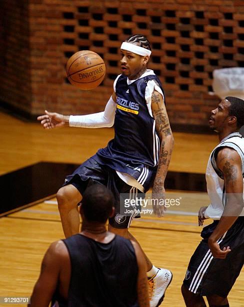 Allen Iverson of the Memphis Grizzlies passes the ball as Mike Conley of the Memphis Grizzlies trails him during the Memphis Grizzlies training camp...