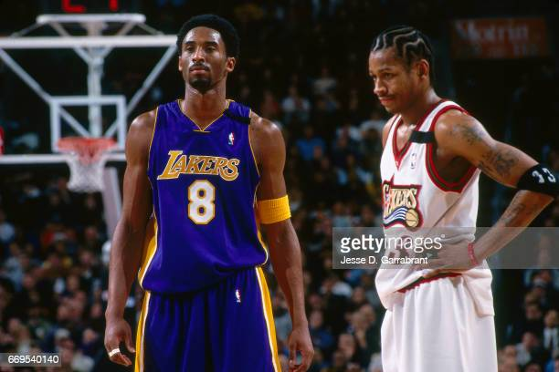 Allen Iverson of the Philadelphia 76ers and Kobe Bryant of the Los Angeles Lakers stand during a game played on February 20 2000 at the Wachovia...