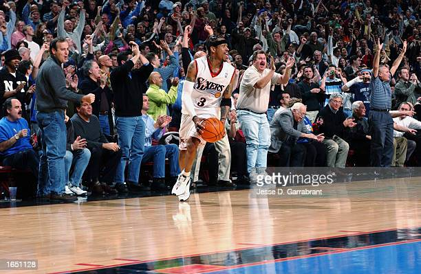 Allen Iverson of the Philadelphia 76ers and the fans celebrate the overtime win at the end of the NBA game against the Los Angeles Clippers at First...