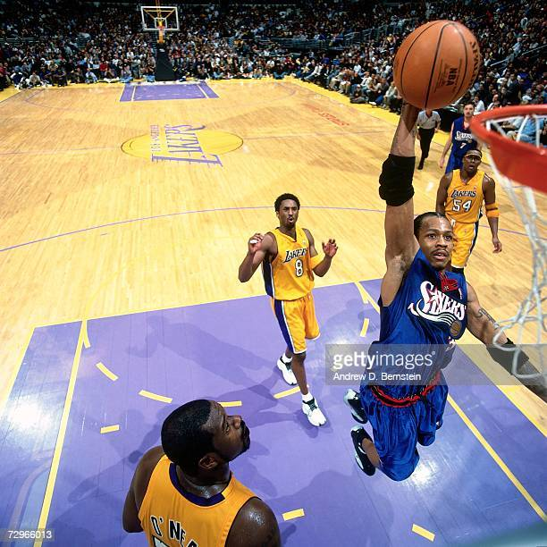 Allen Iverson of the Philadelphia 76ers attempts a dunk against Kobe Bryant of the Los Angeles Lakers during a 2001 NBA Game played at the Staples...