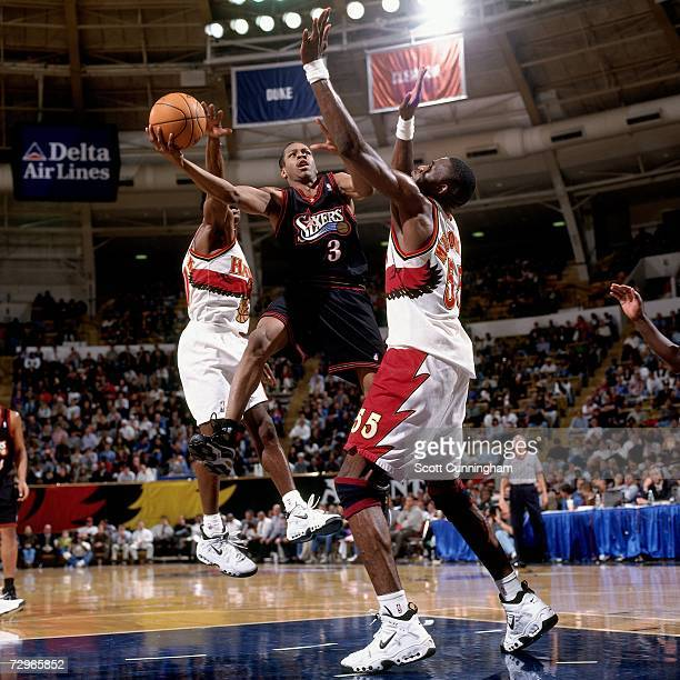 Allen Iverson of the Philadelphia 76ers attempts a layup against Dikembe Mutombo of the Atlanta Hawks during a 1998 NBA Game played at the Phillips...