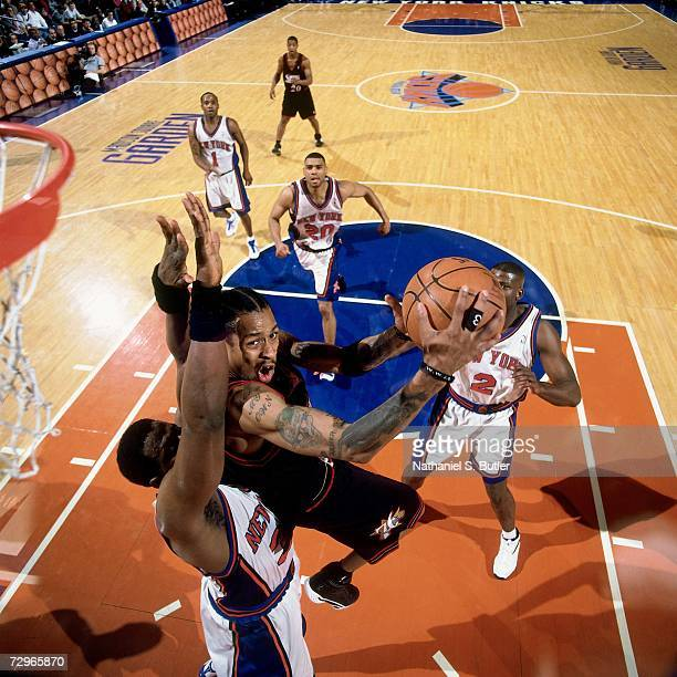 Allen Iverson of the Philadelphia 76ers attempts a layup against Larry Johnson of the New York Knicks during a 2000 NBA Game played at Madison Square...