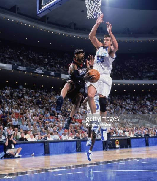 Allen Iverson of the Philadelphia 76ers attempts to shoot over Andrew DeClercq of the Orlando Magic during the NBA preseason game at TD Waterhouse...