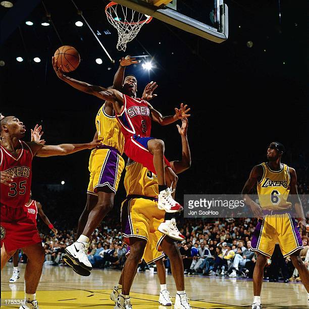 Allen Iverson of the Philadelphia 76ers battles to the basket for an allyoop layup against the Los Angeles Lakers at the Staples Center during the...