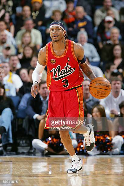 Allen Iverson of the Philadelphia 76ers brings the ball up court against the Golden State Warriors at the Arena in Oakland California NOTE TO USER...