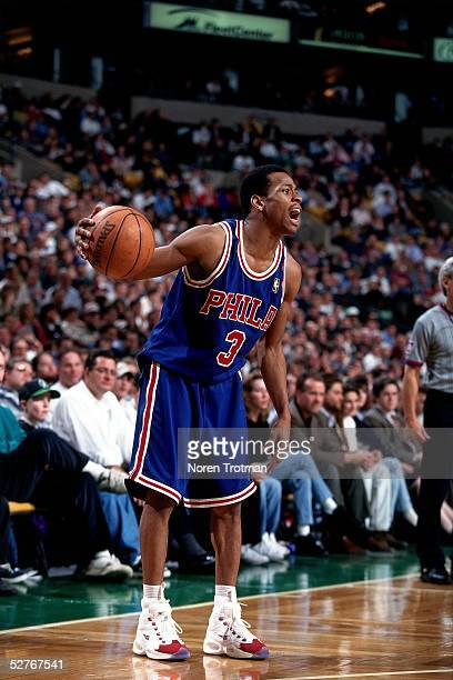 Allen Iverson of the Philadelphia 76ers calls to a teammate to set up the play against the Boston Celtics during an NBA game at Boston Garden on...