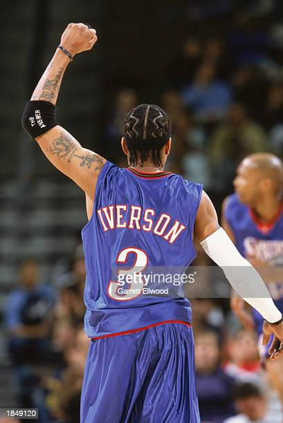 Allen Iverson of the Philadelphia 76ers celebrates during the game against the Denver Nuggets at Pepsi Center on March 2 2003 in Denver Colorado The...