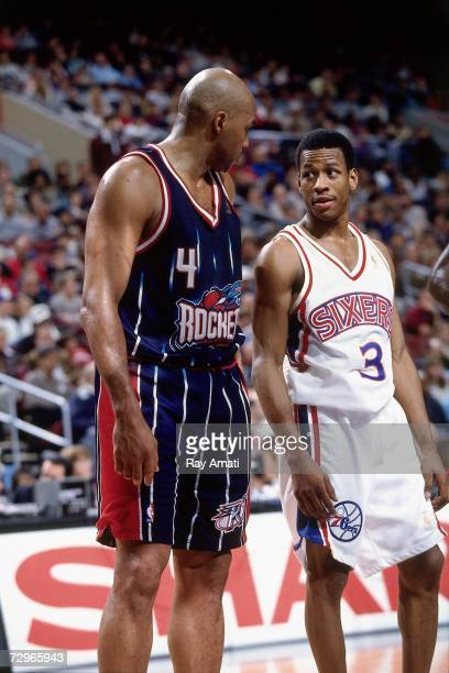 Allen Iverson of the Philadelphia 76ers chats with Charles Barkley of the Houston Rockets during a 1997 NBA Game played at the First Union Center in...