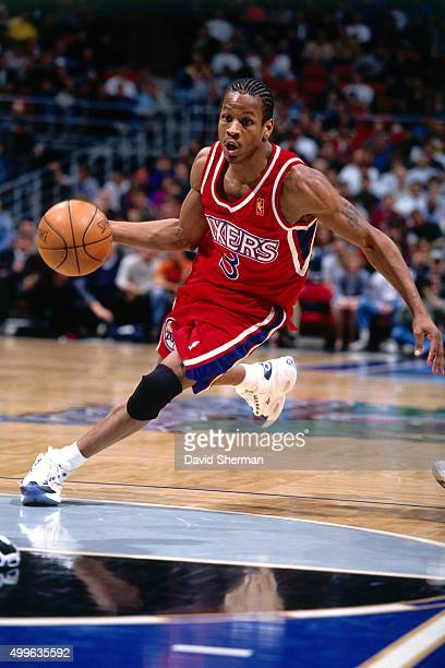 Allen Iverson of the Philadelphia 76ers dribbles against the Minnesota Timberwolves during a game played circa 1997 at the Target Center in...