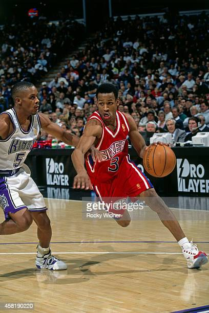 Allen Iverson of the Philadelphia 76ers dribbles against the Sacramento Kings on January 5, 1997 at Arco Arena in Sacramento, California. NOTE TO...