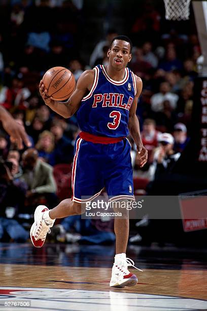 Allen Iverson of the Philadelphia 76ers dribbles the ball upcourt against the New York Knicks during an NBA game at Madison Square Garden on November...