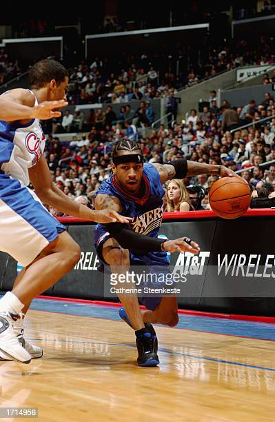 Allen Iverson of the Philadelphia 76ers drives against Andre Miller of the Los Angeles Clippers during the game at Staples Center on December 31 2002...