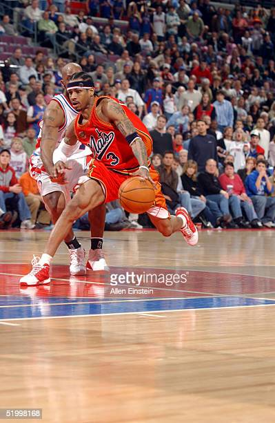 Allen Iverson of the Philadelphia 76ers drives against Chauncey Billups of the Detroit Pistons at the Palace of Auburn Hills on January 15 2005 in...