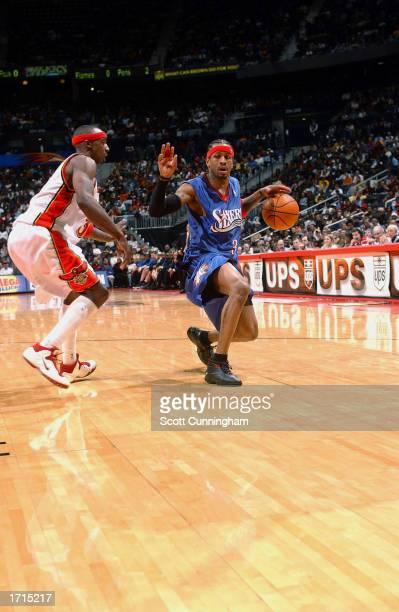 Allen Iverson of the Philadelphia 76ers drives against Jason Terry of the Atlanta Hawks during the NBA game at Philips Arena on December 21 2002 in...