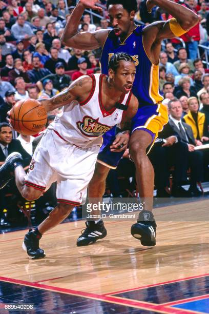 Allen Iverson of the Philadelphia 76ers drives against Kobe Bryant of the Los Angeles Lakers during a game played on February 20 2000 at the Wachovia...