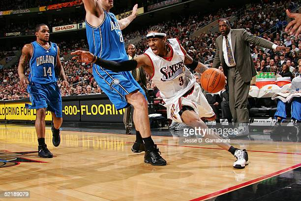 Allen Iverson of the Philadelphia 76ers drives against Pat Garrity of the Orlando Magic on February 12 2005 at the Wachovia Center in Philadelphia...