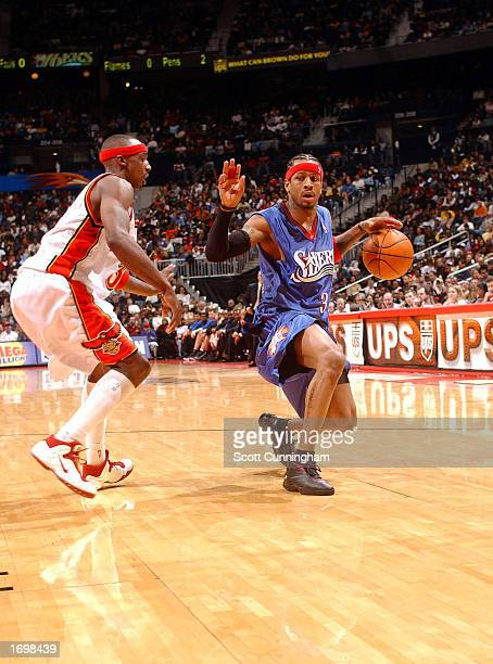 Allen Iverson of the Philadelphia 76ers drives against the Atlanta Hawks on December 21 2002 at the Philips Arena in Atlanta Georgia NOTE TO USER...