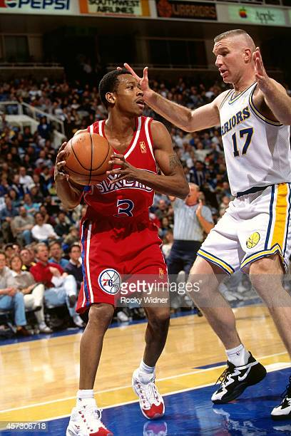 Allen Iverson of the Philadelphia 76ers drives against the Golden State Warriors on January 3, 1997 at the Arena in Oakland in Oakland, California....