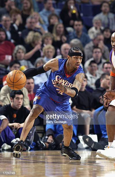 Allen Iverson of the Philadelphia 76ers drives against the Phoenix Suns during the game at America West Arena on January 2 2003 in Phoenix Arizona...