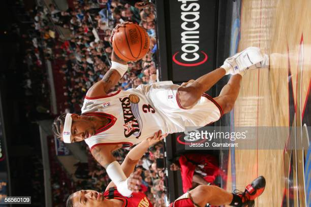 Allen Iverson of the Philadelphia 76ers drives against Tyronn Lue of the Atlanta Hawks December 14 2005 at the Wachovia Center in Philadelphia...