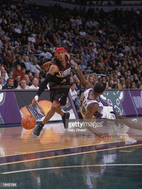 Allen Iverson of the Philadelphia 76ers drives around Michael Redd of the Milwaukee Bucks during the game at Bradley Center on November 9 2002 in...