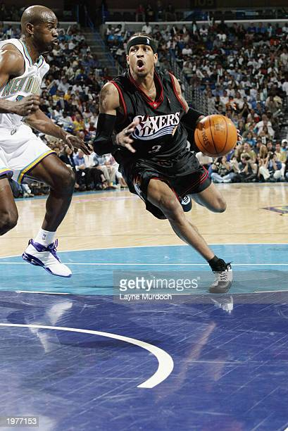 Allen Iverson of the Philadelphia 76ers drives around Robert Pack of the New Orleans Hornets in Game three of the Eastern Conference Quarterfinals...