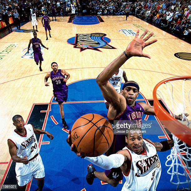 Allen Iverson of the Philadelphia 76ers drives for a layup against Vince Carter of the Toronto Raptors during an NBA game at the First Union Center...