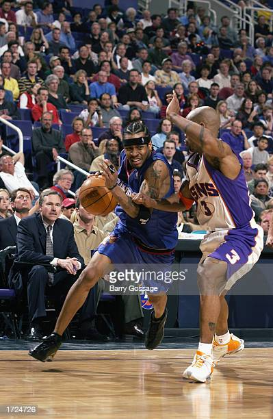 Allen Iverson of the Philadelphia 76ers drives on Stephon Marbury of the Phoenix Suns during the game at America West Arena on January 2 2003 in...