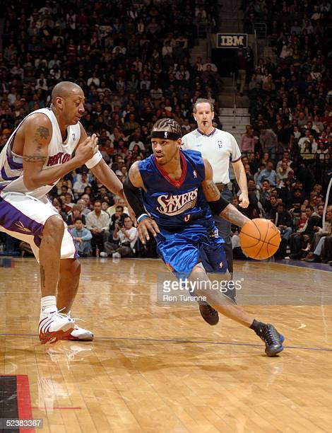 Allen Iverson of the Philadelphia 76ers drives past Donyell Marshall of the Toronto Raptors on March 13 2005 at the Air Canada Centre in Toronto...