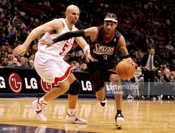Allen Iverson of the Philadelphia 76ers drives past Jason Kidd of the New Jersey Nets during their game at Continental Airlines Arena on December 10...