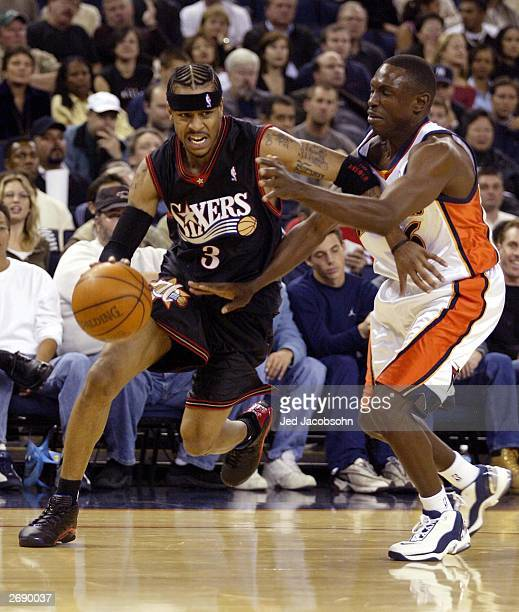 Allen Iverson of the Philadelphia 76ers drives past Speedy Claxton of the Golden State Warriors during an NBA game at the Arena in Oakalnd November 1...