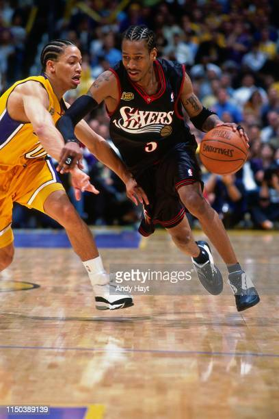 Allen Iverson of the Philadelphia 76ers drives past Tyronn Lue of the Los Angeles Lakers during Game One of the 2001 NBA Finals on June 6, 2001 at...
